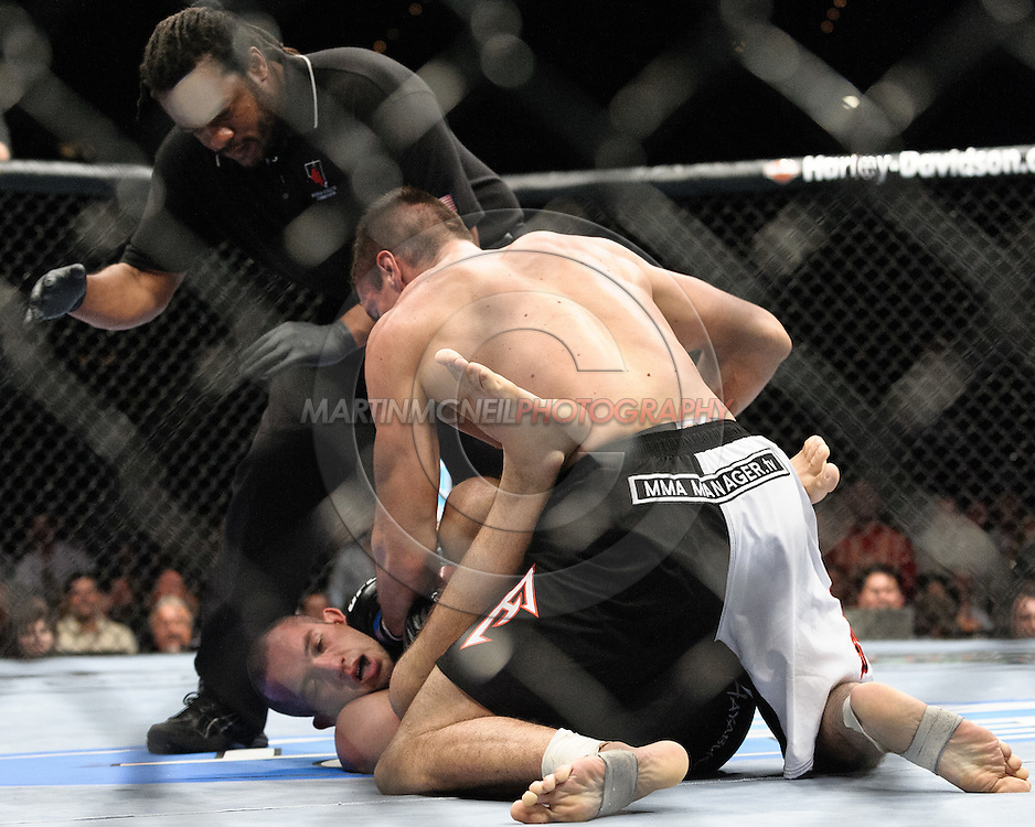 "LAS VEGAS, NEVADA, MAY 24, 2008: Referee Herb Dean (facing) stands ready to intervene as Goran Reljic (top) pounds on a defenceless Wilson Gouveia during ""UFC 84: Ill Will"" inside the MGM Grand Garden Arena in Las Vegas"