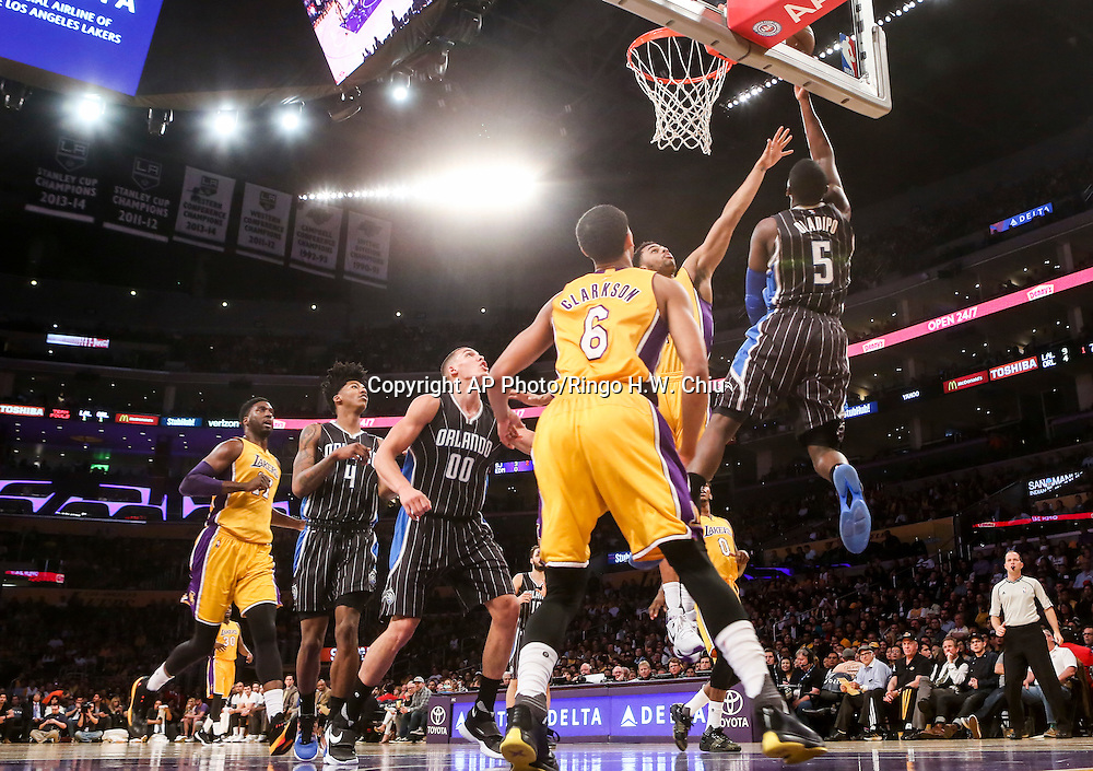 Orlando Magic guard Victor Oladipo, right, goes up for a lay up against Los Angeles Lakers during the first half of an NBA basketball game Tuesday, March 8, 2016, in Los Angeles.  (AP Photo/Ringo H.W. Chiu)