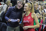 England Women GS Helen Housby takes a selfie with a fan after the Netball World Cup 2019 Preparation match between England Women and Uganda at Copper Box Arena, Queen Elizabeth Olympic Park, United Kingdom on 30 November 2018.