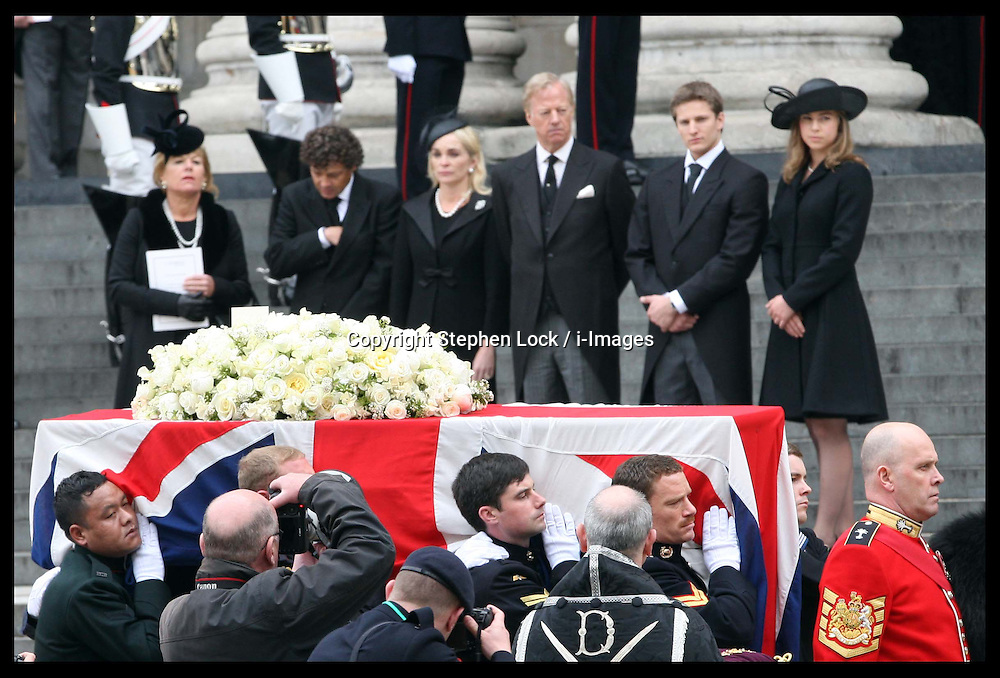 Baroness Thatcher's family watch her coffin leaving  St.Paul's Cathedral in London , Wednesday 17th  April 2013 Photo by: Stephen Lock / i-Images