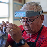 Silversmith Merlin Yazzie works on a ring July 14 at his home studio in White Cone. Yazzie will participate in the National Heirloom Exposition in Santa Rosa, CA September 6-8.