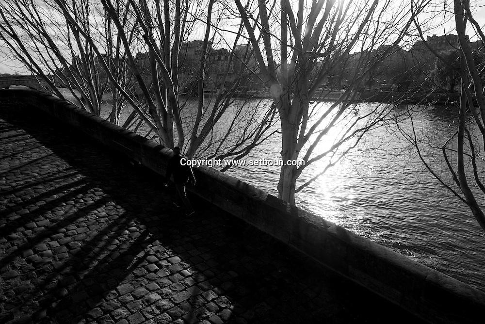 France. Paris. 1st district. the quay du Louvre on  the seine river, in the distance the left bak and ile de la cite