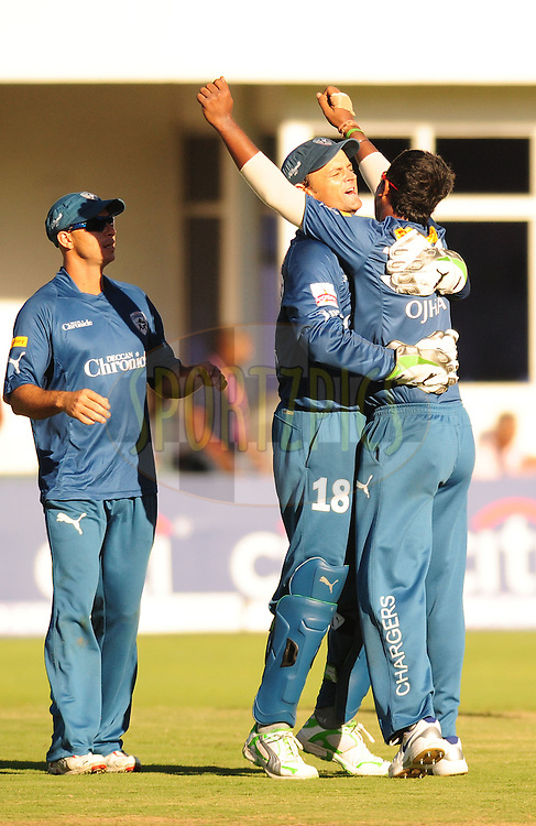 PORT ELIZABETH, SOUTH AFRICA - 2 May 2009.  Ohja gets a hug from his captain Gilchrist as Gibbs watches during the  IPL Season 2 match between the Deccan chargers vs Rajasthan Royals held at St Georges Park in Port Elizabeth , South Africa.