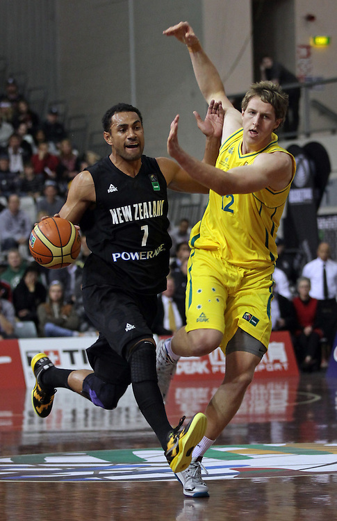 New Zealand's Mika Vukona is blocked by Australia's Cameron Bairstow in the 2013 FIBA Oceania Championship basketball match, North Shore Events Centre, Auckland, New Zealand, Wednesday, August 14, 2013.  Credit:SNPA / David Rowland