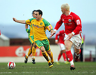 London - Saturday, January 12th, 2008: Bobby Hassell of Barnsley and Lee Croft of Norwich City during the Coca Cola Champrionship match at Oakwell, Barnsley. (Pic by Paul Hollands/Focus Images)