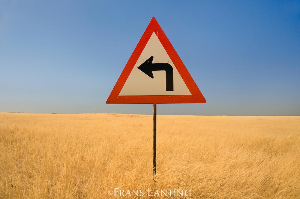 Turn left traffic sign, Namib-Naukluft National Park, Namibia