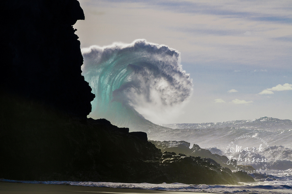 The incredible power of the ocean is shown above in Cliff Curl, an award winning photograph. The strange shape to this wave was made when the backwash coming off the cliff from the previous wave hit this incoming wave.