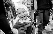 Children with big smile and big eyes in market