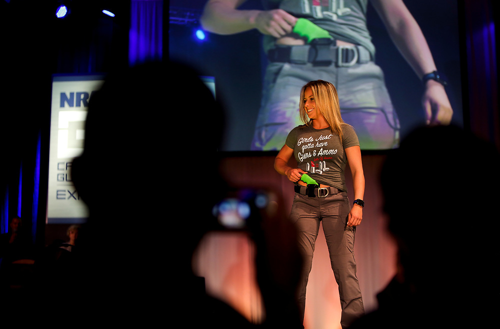 Isbel Montano with Maiden Apparel shows off a concealed carry holster during the National Rifle Association (NRA) Carry Guard Expo Fashion Show in Milwaukee, Wisconsin, U.S., August 25, 2017.   REUTERS/Ben Brewer