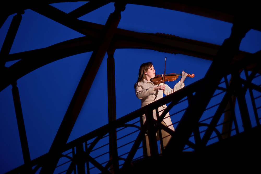 "Laura Anderson-Schleiger, 24, plays the violin on a bridge above 15th street in Denver, Tuesday, Dec. 22, 2009. ""There's so much you can portray as a musician without ever saying anything and it's been apart of my my life, my whole life, so I don't know any different,"" said the veteran of 20 years."