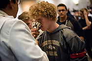 A student receives the Sacrament during worship on Friday, Jan. 27, 2017, in Arlington, Va. LCMS Communications/Erik M. Lunsford