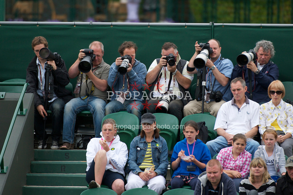LONDON, ENGLAND - Saturday, June 25, 2011: Photographers during the Ladies' Singles 3rd Round match on day six of the Wimbledon Lawn Tennis Championships at the All England Lawn Tennis and Croquet Club. (Pic by David Rawcliffe/Propaganda)