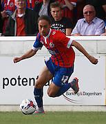 Dagenham player Jodi Jones surges forward during the Sky Bet League 2 match between Dagenham and Redbridge and Newport County at the London Borough of Barking and Dagenham Stadium, London, England on 19 September 2015. Photo by Bennett Dean.