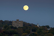 Highland, New York - The full moon rises over Poughkeepsie on Oct. 18, 2013.