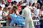 Moeen Ali of England signs a a fancy dressed fans blow up shark during day two of the fourth SpecSavers International Test Match 2018 match between England and India at the Ageas Bowl, Southampton, United Kingdom on 31 August 2018.