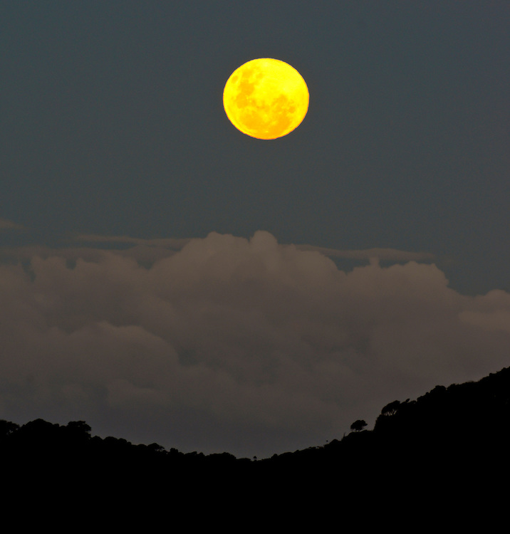 Largest full moon of the year rising above frontal storm clouds, seen from Sandy Bay, Tutukaka Coast, Northland, Sunday June 23, 2013. Credit: SNPA / Malcolm Pullman