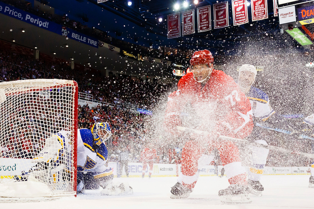 Mar 22, 2015; Detroit, MI, USA; Detroit Red Wings right wing Erik Cole (72) and St. Louis Blues defenseman Barret Jackman (5) go after the puck in the second period at Joe Louis Arena. Mandatory Credit: Rick Osentoski-USA TODAY Sports