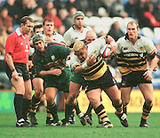 Zurich Premiership Rugby - London Irish v Wasps..Wasp's Hooker, Trevor Loeta breaks, under the watchful eyes of referee John Barnard. during the game at the Madejski Stadium, Reading, Berks, Great Britain. [Mandatory Credit: Peter Spurrier; Intersport Images].
