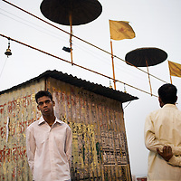 Pilgrims at Varanasi's ghats after bathing in the sacred Ganges river. The ghats attract millions of Hindu pilgrims from across India every year. ..Photo: Tom Pietrasik.Varanasi, India.March 6th 2008.