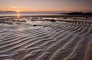 Dunstaborough Castle and Embleton Bay at dawn.  Northumberland, UK