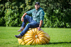 © Licensed to London News Pictures. 13/09/2019. Harrogate UK. Richard Mann with his winning heaviest pumpkin weighing 291.7 kg at the giant vegetable competition at the Harrogate Flower Show in Harrogate today in Yorkshire. Photo credit: Andrew McCaren/LNP