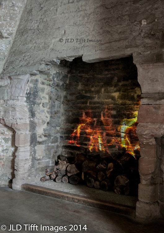Image of a burning fire is projected onto the back of a fireplace in the castle, simulating a real one.