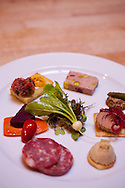 """Beast is a six-course, prix fixe restaurant in NE Portland, Oregon whose menu changes every Wednesday.  Chef Naomi Pomeroy (and single mom) and partner Micah Paredes focus on local ingredients in a style which they call """"refined French grandmother.""""  Pictured here is the charcuterie plate: fois gras bon bon with a sauternes geleé, steak tartare & quail egg toast, pork, pork liver, sour cherry & pistachio pate, chicken liver mousse with pickled shallot."""