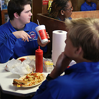 Jack Baker of the Mayor's Youth Council enjoys lunch at Johnnie's Drive-In Saturday as their first stop on their tour about Elvis Presley