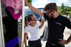 CANYON//SRAM Racing soigneur, Alessandra Borchi and CANYON//SRAM Racing Physiotherapist, Lars Schiffner joke around before Giro Rosa 2018 - Stage 1, a 15.5 km team time trial in Verbania, Italy on July 6, 2018. Photo by Sean Robinson/velofocus.com