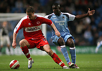 Photo: Paul Thomas.<br /> Manchester City v Middlesbrough. The Barclays Premiership. 30/10/2006.<br /> <br /> Robert Huth (L) of Middlesborough keeps the ball from Micah Richards.