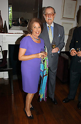 VALERIE KLEEMAN and ALAN WHICKER at a party to launch her atest collection held at Morton's, Berkeley Square, Lonon W1 on 11th September 2006.<br />