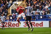 Atdhe Nuhiu of Sheffield Wednesday competes for the ball with Bristol City FC vice captain Josh Brownhill during the EFL Sky Bet Championship match between Sheffield Wednesday and Bristol City at Hillsborough, Sheffield, England on 22 December 2019.