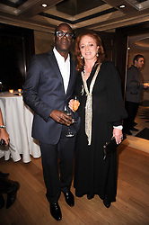 CAMILLA LOWTHER and CHARLES ABOAH at a dinner hosted by jewellers Damiani at The Connaught Hotel, London on 3rd February 2010.