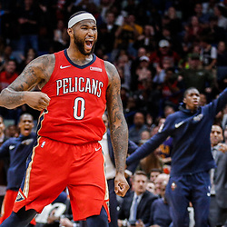 Dec 13, 2017; New Orleans, LA, USA; New Orleans Pelicans center DeMarcus Cousins (0) reacts after a dunk by guard E'Twaun Moore (not pictured) during the fourth quarter against the Milwaukee Bucks at the Smoothie King Center. The Pelicans defeated the Bucks 115-108. Mandatory Credit: Derick E. Hingle-USA TODAY Sports