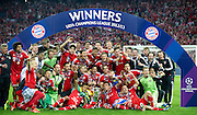 Bayern Munich team with the trophy pose to teamhoto after winnig the UEFA Champions League Final football match between Borussia Dortmund and Bayern Munich at Wembley Stadium in London on May 25, 2013...England, London, May 25, 2013..Picture also available in RAW (NEF) or TIFF format on special request...For editorial use only. Any commercial or promotional use requires permission...Photo by © Adam Nurkiewicz / Mediasport