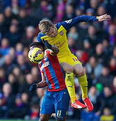 LONDON, ENGLAND - Saturday, February 21, 2015: Arsenal's Nacho Monreal in action against Crystal Palace's Wilfried Zaha during the Premier League match at Selhurst Park. (Pic by David Rawcliffe/Propaganda)
