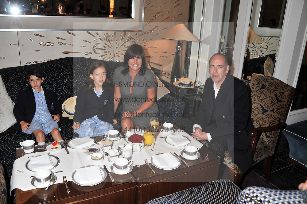 MICK & MIRANDA JONES and their daughters left to right, AVA & STELLA at the launch of Stephen Webster Bijoux Tea held at the Langham Hotel, Portland Place, London on 13th September 2011.