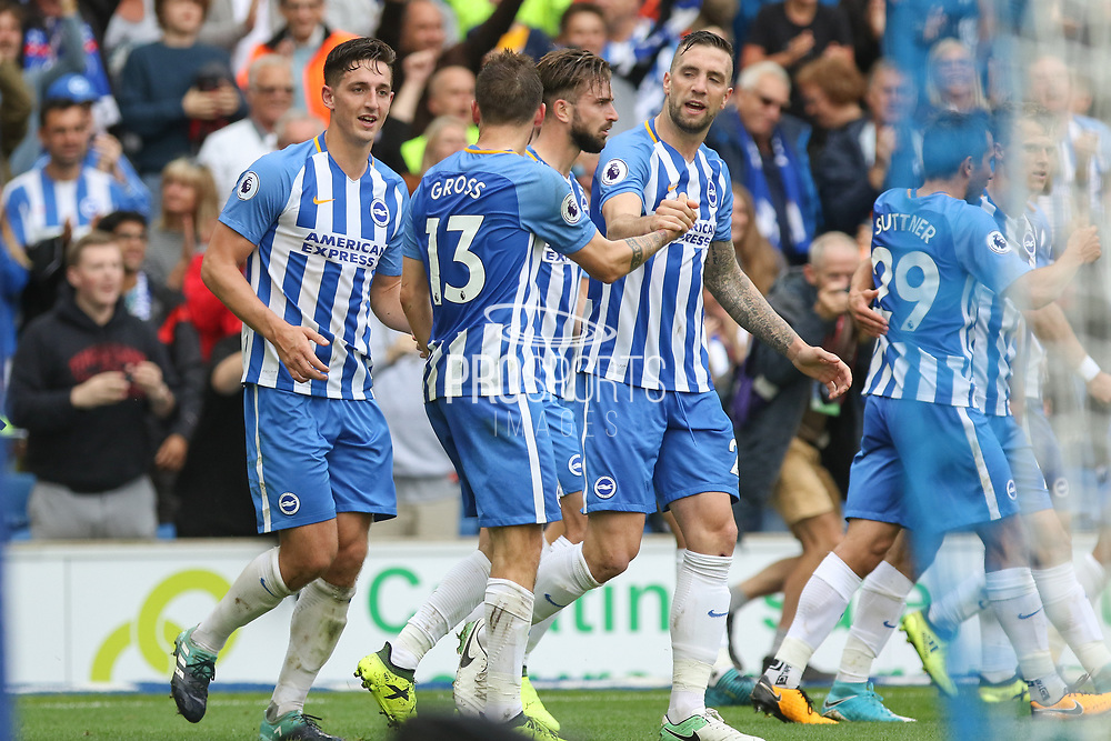 Brighton and Hove Albion midfielder Pascal Gross (13) celebrates with  Brighton and Hove Albion defender Shane Duffy (22) after his goal 1-0 during the Premier League match between Brighton and Hove Albion and West Bromwich Albion at the American Express Community Stadium, Brighton and Hove, England on 9 September 2017. Photo by Phil Duncan.