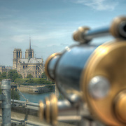 "From the top floor of the ""Institute of the Arab World"" in Paris there is a fine view of the River Seine and Notre Dame Cathedral."