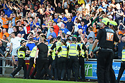 The Police hold back the Oldham fans during the EFL Sky Bet League 1 match between Northampton Town and Oldham Athletic at Sixfields Stadium, Northampton, England on 5 May 2018. Picture by Dennis Goodwin.