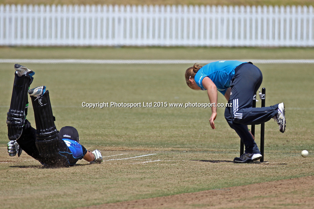 White Ferns Lea Tahuhu dives as England attempt to run her out. 1st one day international, womens cricket match at Bay Oval, Mt Maunganui, 11 February 2015. Copyright Photo: Margot Butcher / www.photosport.co.nz