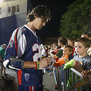 Owen Blye #20 of the Boston Cannons signs an autograph for a fan following the game at Harvard Stadium on August 9, 2014 in Boston, Massachusetts. (Photo by Elan Kawesch)