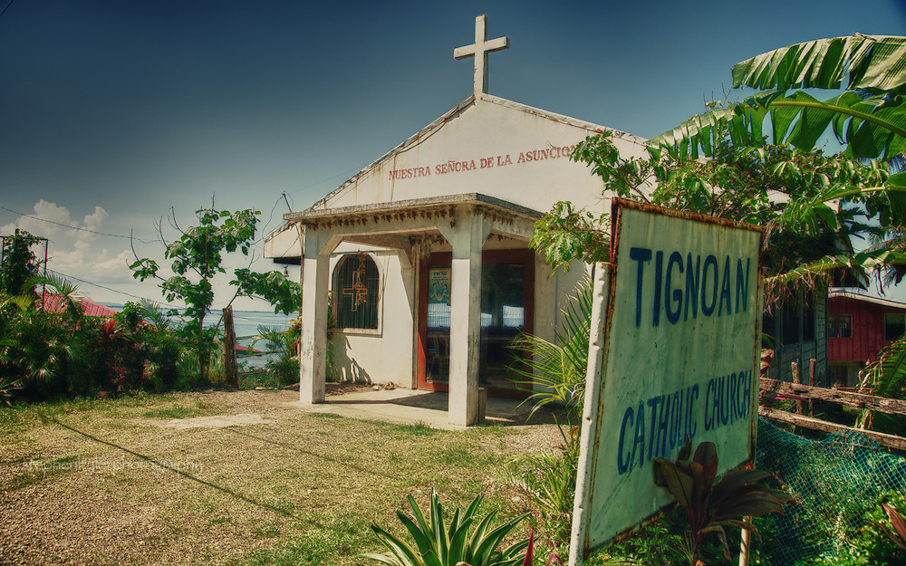 On the Pacific coast of the Philippines in the Quezon province near the municipality of Real, a small church sits to administer to the local Catholic faithful.