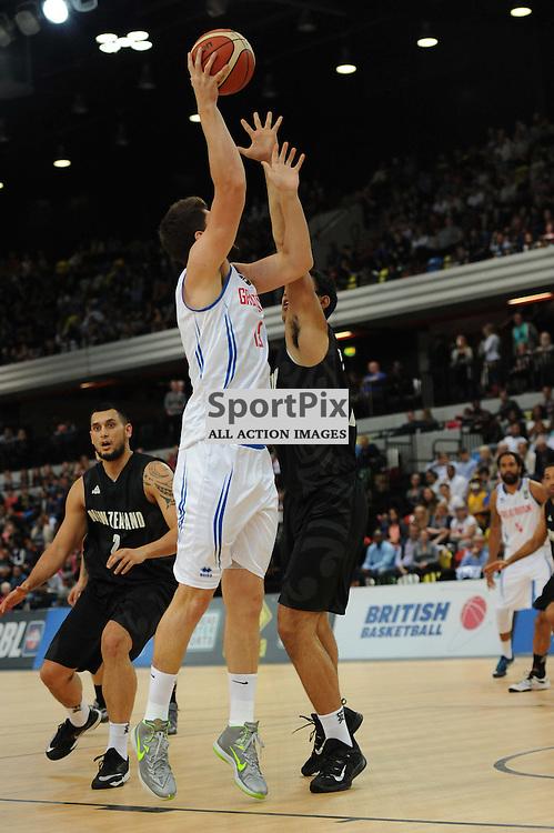 Team GB's Zak Wells takes a shot during the Team GB v Tall Blacks clash in the British Basketball League.
