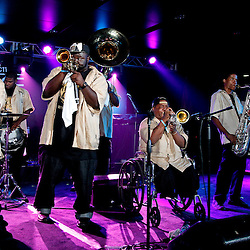 NEW ORLEANS, LOUISIANA - JULY 3: The 'Hot 8 Brass Band' performs in the ESSENCE.com Superlounge during the 2011 Essence Music Festival Day 3 at the Louisiana Superdome on July 3, 2011 in New Orleans, Louisiana. (Photo by Derick E. Hingle)