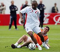 Photo: Chris Ratcliffe.<br />England training session. 06/06/2006.<br />Jermain Defoe gets past Jamie Carragher.
