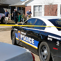 Thomas Wells | BUY at PHOTOS.DJOURNAL.COM<br /> Tupelo police officers and detectives leave the scene of a Monday afternoon murder on Crestview Road.
