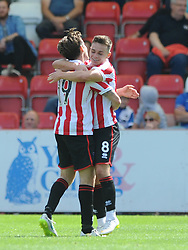 Billy Waters of Cheltenham Town celebrates his goal with James Rowe of Cheltenham Town - Mandatory by-line: Dougie Allward/JMP - 25/07/2015 - SPORT - FOOTBALL - Cheltenham Town,England - Whaddon Road - Cheltenham Town v Bristol Rovers - Pre-Season Friendly