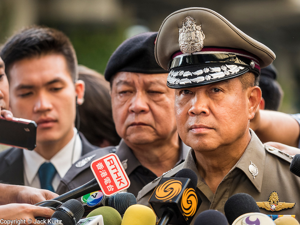 18 AUGUST 2015 - BANGKOK, THAILAND: Thai police chief SOMYOT PUMPUNMUANG answers questions from reporters at the Erawan Shrine Tuesday during the investigation of the bombing of the shrine.  An explosion at Erawan Shrine, a popular tourist attraction and important religious shrine in the heart of the Bangkok shopping district killed at least 20 people and injured more than 120 others, including foreign tourists, during the Monday evening rush hour. Twelve of the dead were killed at the scene. Thai police said an Improvised Explosive Device (IED) was detonated at 18.55. Police said the bomb was made of more than six pounds of explosives stuffed in a pipe and wrapped with white cloth. Its destructive radius was estimated at 100 meters.    PHOTO BY JACK KURTZ
