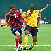 Jamaica Defender Shavar Thomas #4 and Midfielder Alejandro Bedoya #22 battle for the ball in the first half. The United State would go on to to defeat Jamaica 2-0 in the concacaf gold cup quarterfinals Sunday, June 19, 2011 at  RFK Stadium in Washington DC.
